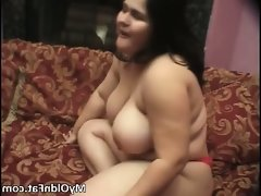 Big boobed obese brunette slut stripping