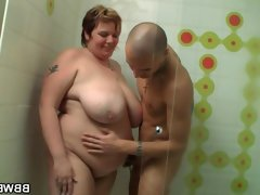 Dude fucks fat lady in the shower cabin