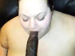 Pale fat chick devouring a black dick