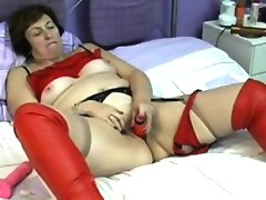 Gran in red boots fuks here pussy